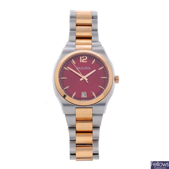 BULOVA - a mid-size bi-colour bracelet watch.
