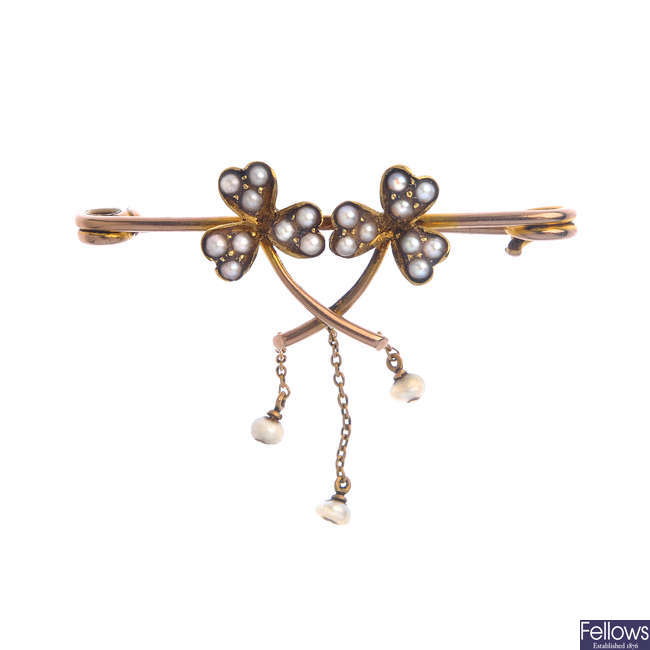 An early 20th century 9ct gold seed and split pearl clover brooch.
