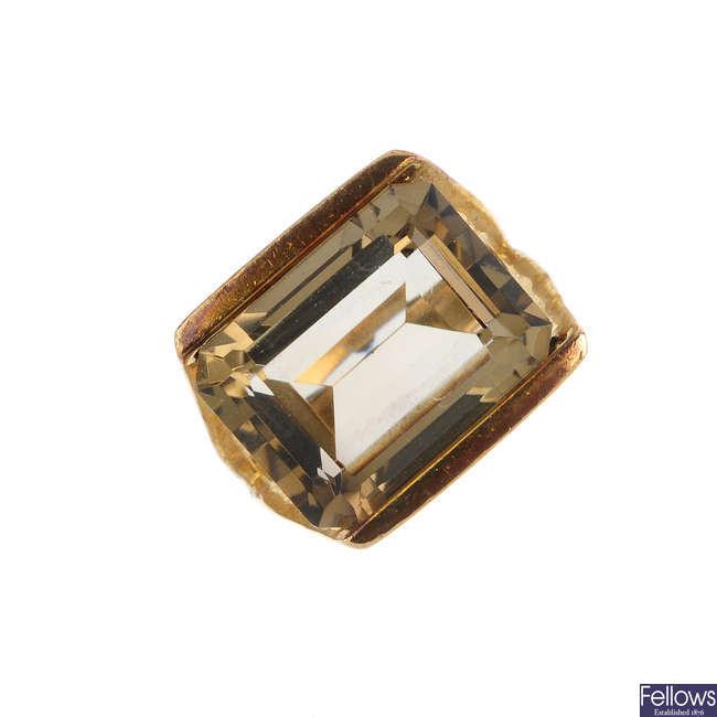 A smoky quartz single-stone ring.