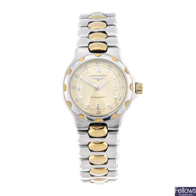 LONGINES - a lady's bi-metal Conquest bracelet watch.