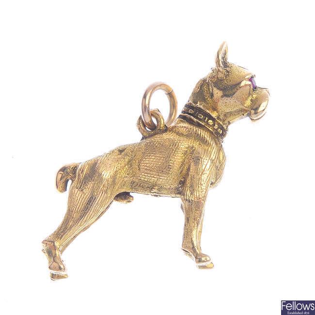 A 9ct gold ruby dog charm.