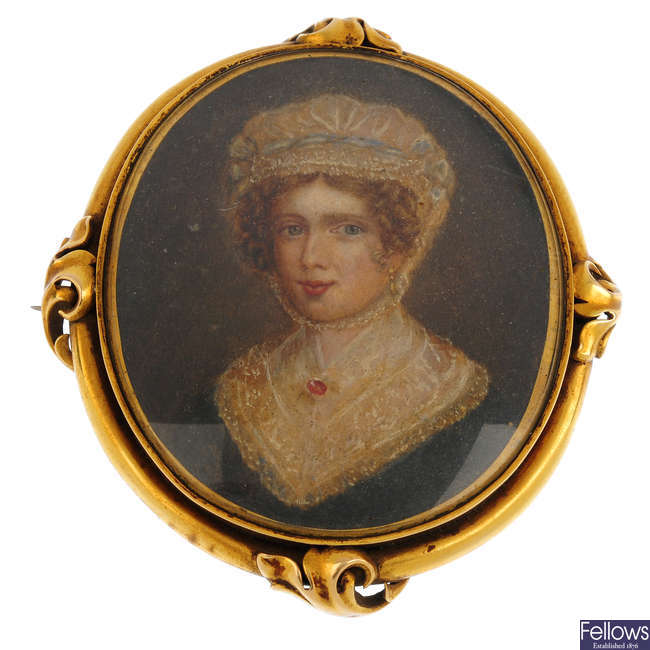 A late Georgian/Regency gold mounted hand painted portrait miniature brooch.