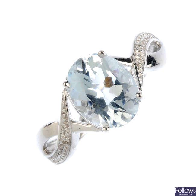 A 9ct gold aquamarine and diamond ring.