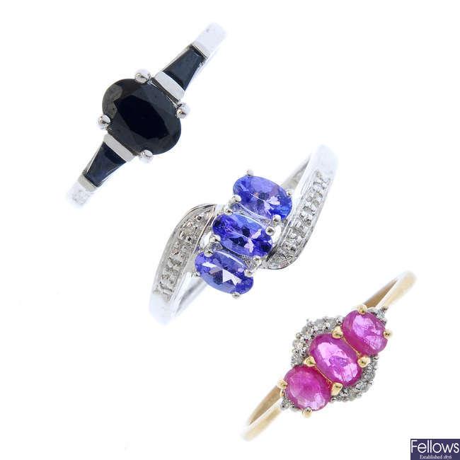 Four diamond and gem-set rings.