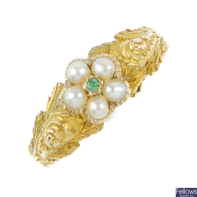 A mid Victorian split pearl and green gem memorial ring.
