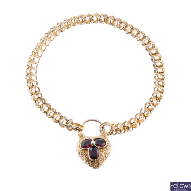 A mid Victorian garnet and paste heart padlock memorial clasp with bracelet.