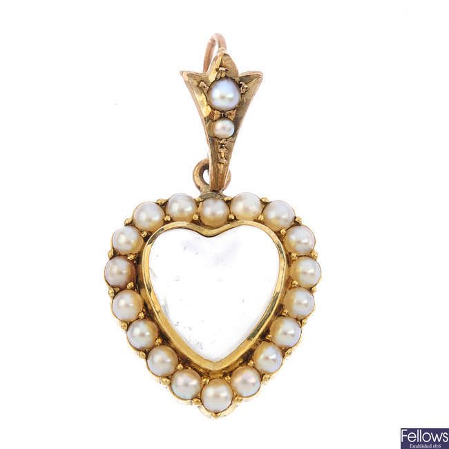 An early 20th century 9ct gold moonstone and split pearl pendant.