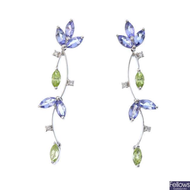 A pair of 18ct gold gem-set earrings.