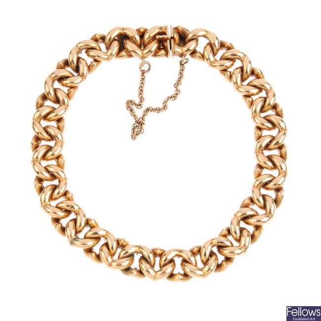 An early 20th century 15ct gold fancy curb-link bracelet.