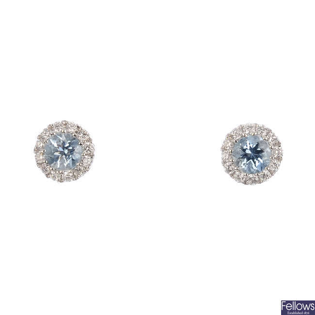 A pair of 18ct gold aquamarine and diamond stud earrings.