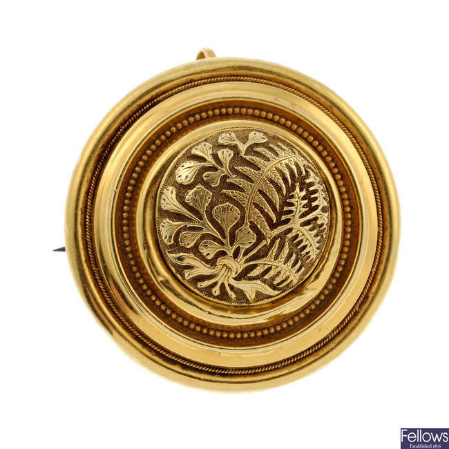 A mid Victorian 18ct gold mourning brooch.