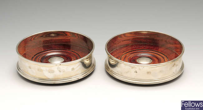 A pair of modern silver mounted wine coasters.