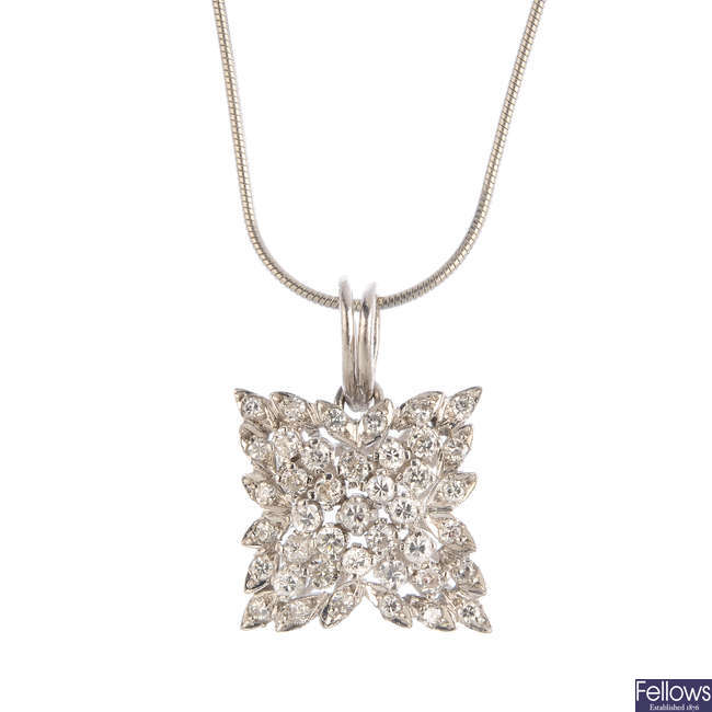 An 18ct gold diamond pendant, with platinum De Beers chain.