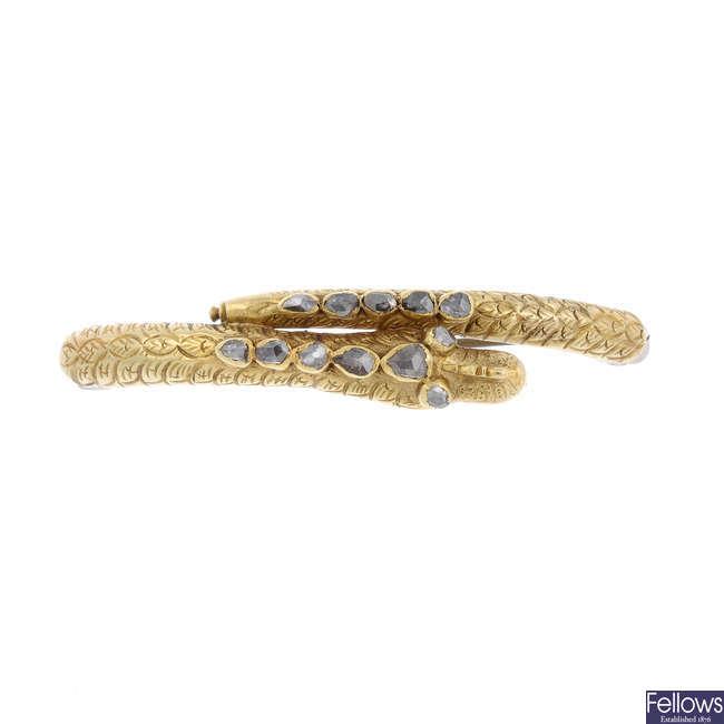 A mid Victorian 18ct gold diamond snake brooch.