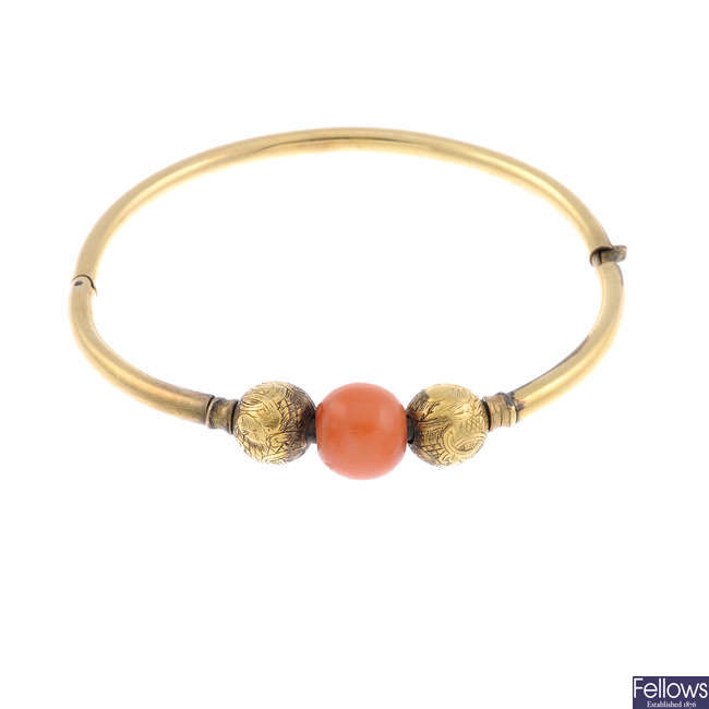 A late 19th century gold coral bangle.