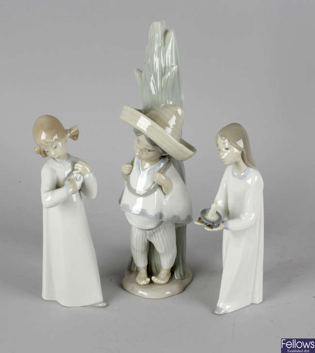 A group of Lladro and other porcelain figures