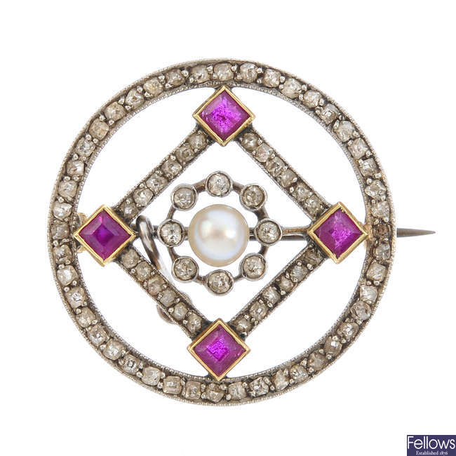 An early 20th century platinum and gold pearl, ruby and diamond brooch.
