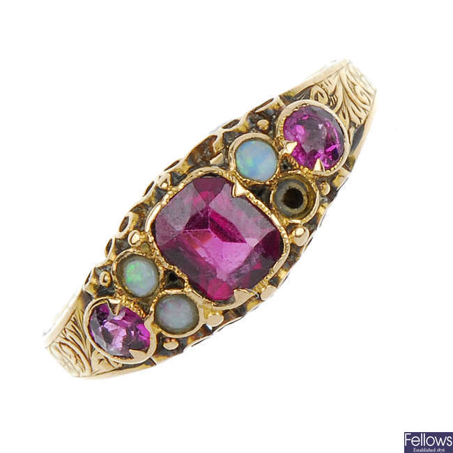 A mid Victorian 15ct gold garnet and opal ring.