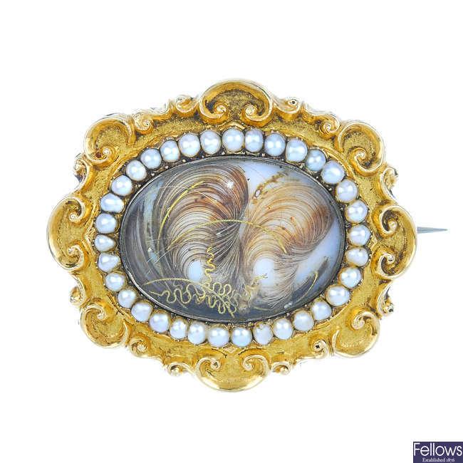 An early Victorian gold split pearl memorial brooch.