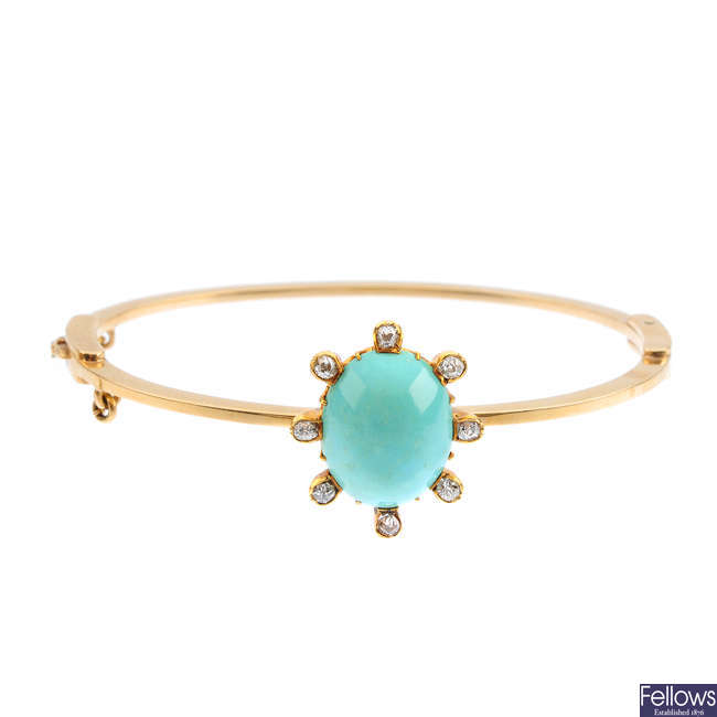An early 20th century gold turquoise and diamond hinged bangle.