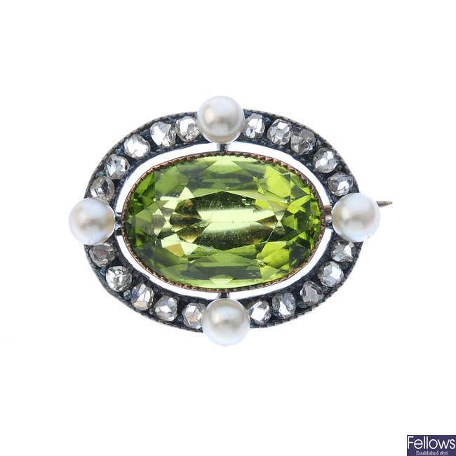 A peridot, seed pearl and diamond brooch.