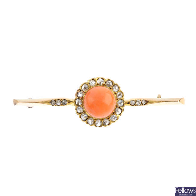 An early 20th century gold, coral and diamond bar brooch.