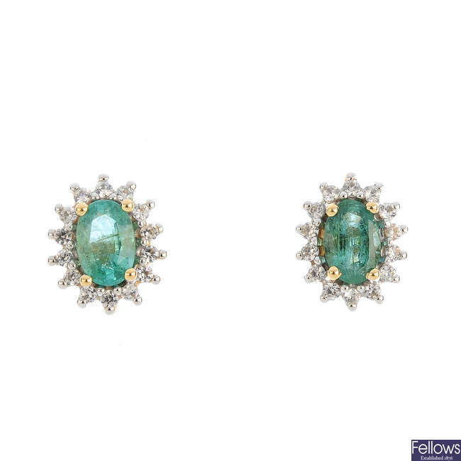 A pair of emerald and colourless gem earrings.
