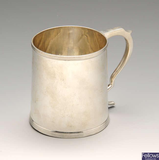 An early twentieth century silver mug.