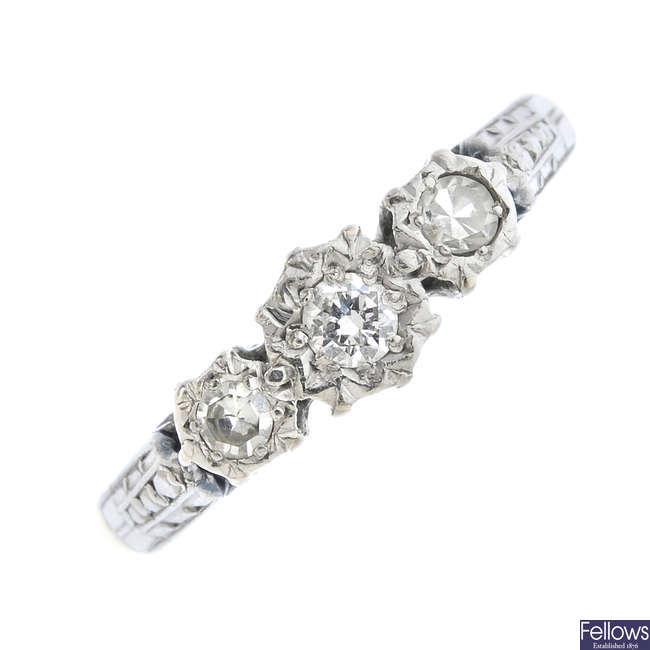 A mid 20th century 18ct gold and platinum diamond three-stone ring.