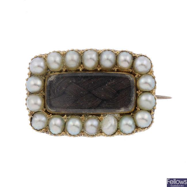 A mid Victorian memorial split pearl brooch.