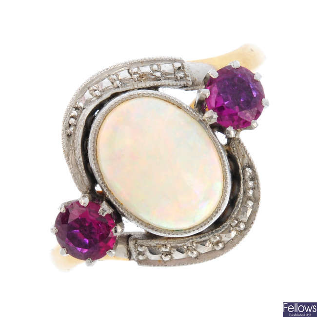 An early 20th century gold, opal and ruby ring.