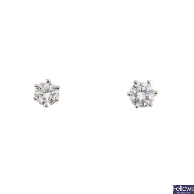 A pair of brilliant-cut diamond stud earrings.