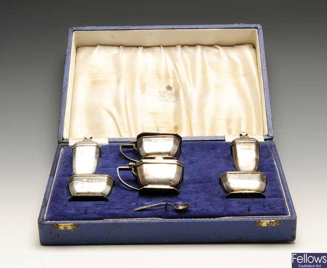 A mid-twentieth century silver condiment set & a 1930's silver sauce boat. (2).