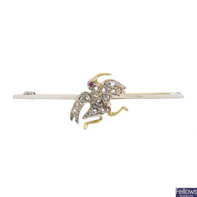 A diamond bird brooch.