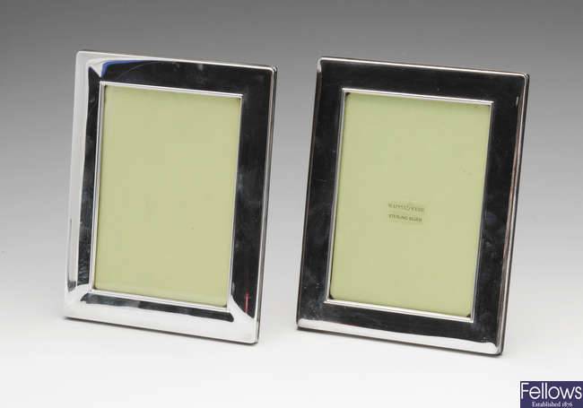 A pair of modern silver mounted photograph frames.
