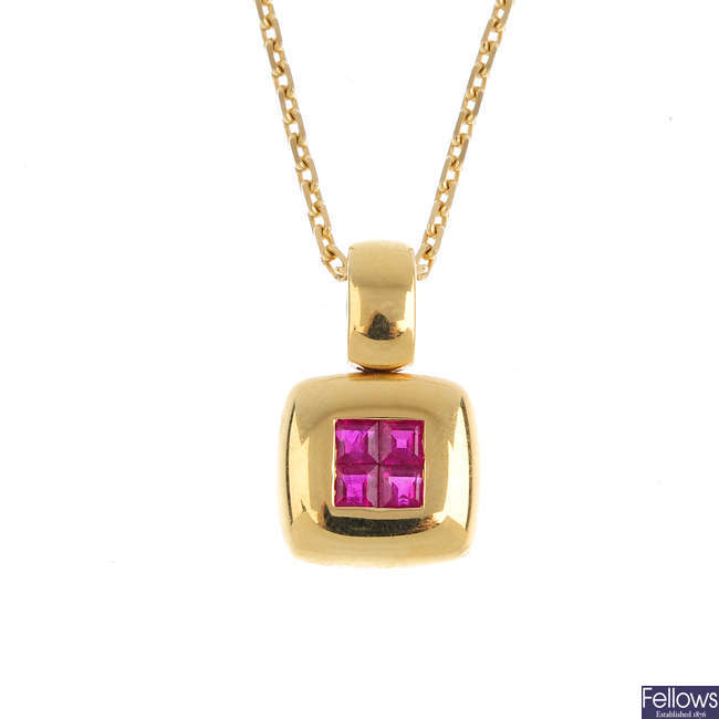 A ruby pendant, with chain.