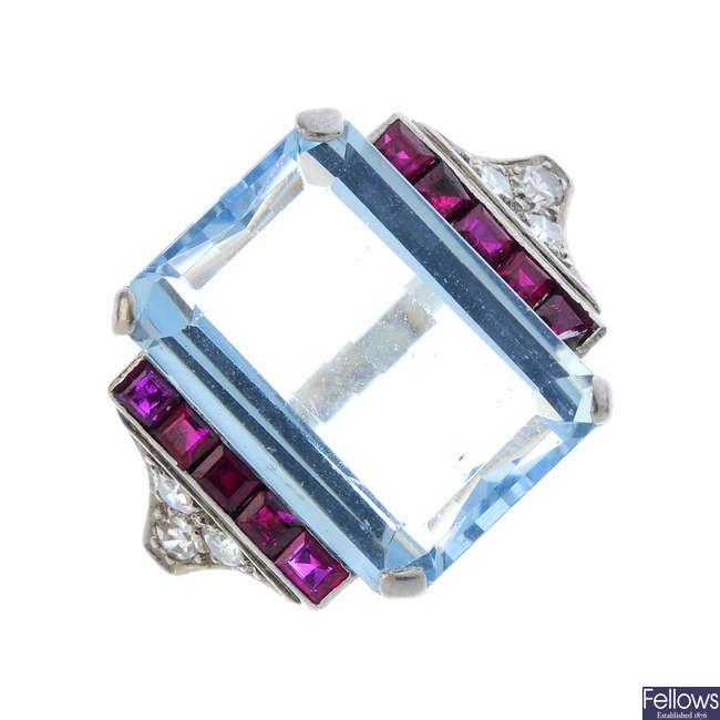 A 1940s aquamarine, ruby and diamond cocktail ring.