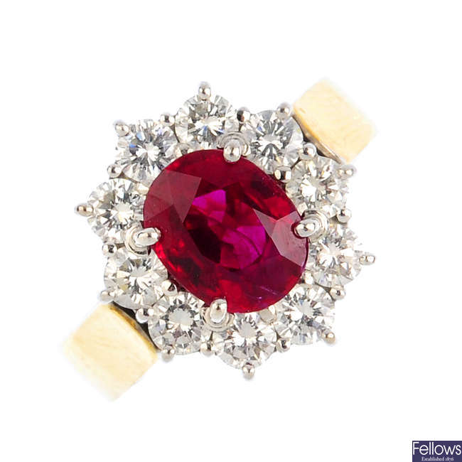 A Burmese ruby and diamond cluster ring.