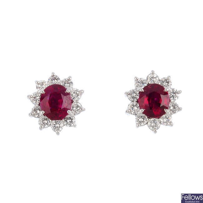 A pair of Burmese ruby and diamond cluster earrings.