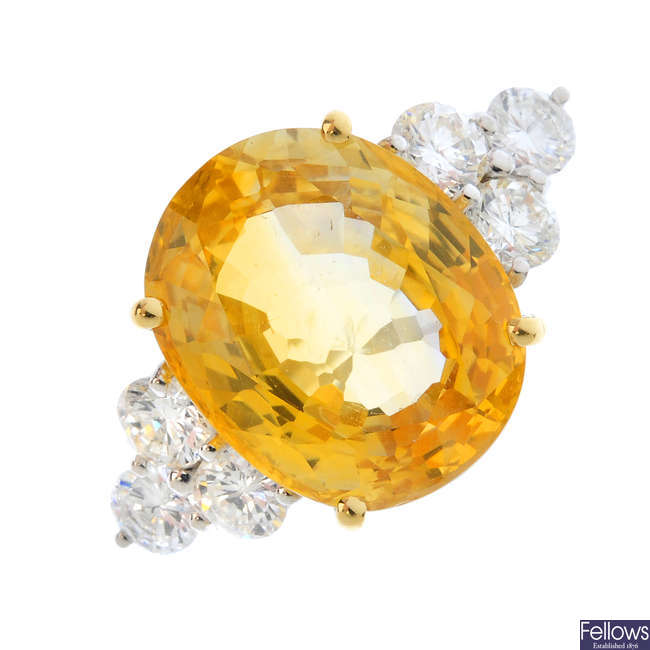 A yellow sapphire and diamond dress ring.