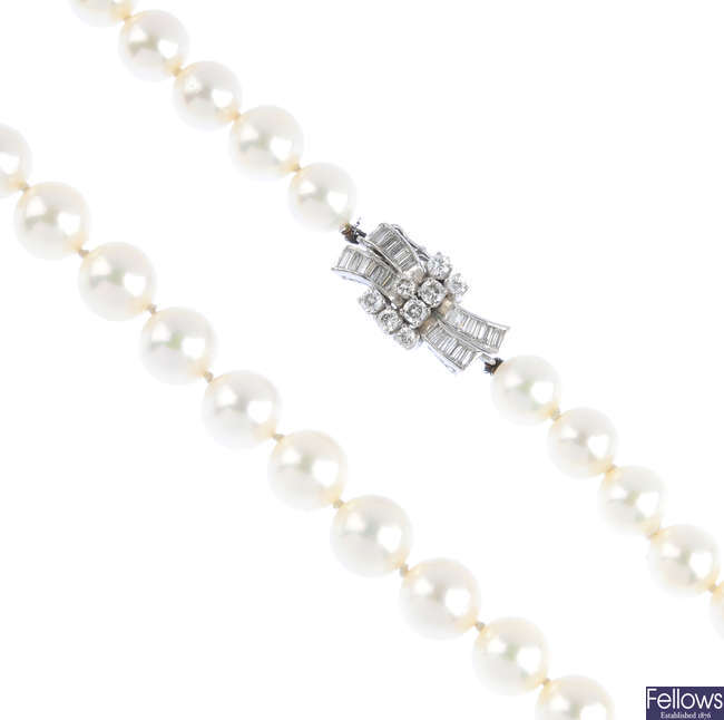 A cultured pearl single-strand necklace, with diamond clasp.