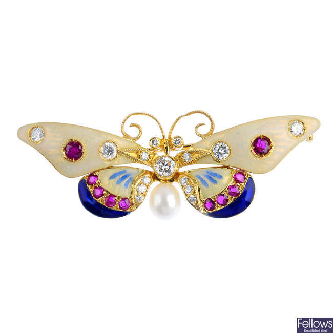 A diamond, ruby and enamel butterfly brooch.