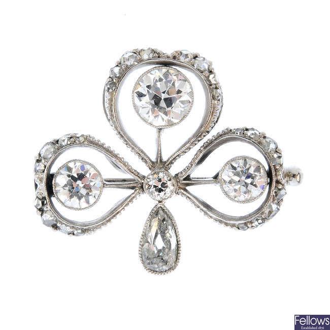 An early 20th century diamond shamrock brooch.