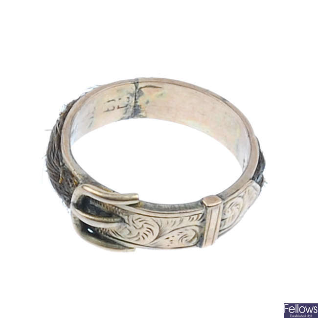 A late Victorian 9ct gold woven hair buckle memorial ring.