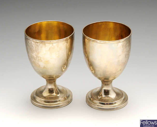 A pair of George III silver goblets.