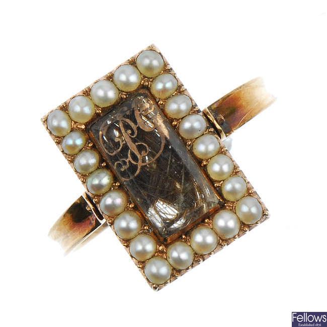 A mid Victorian gold split pearl memorial swivel ring.