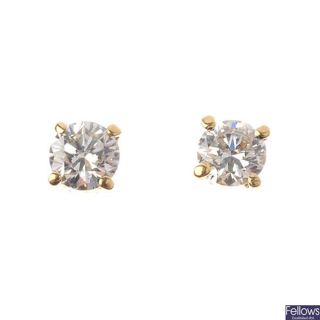A pair of 18ct gold brilliant-cut diamond stud earrings.