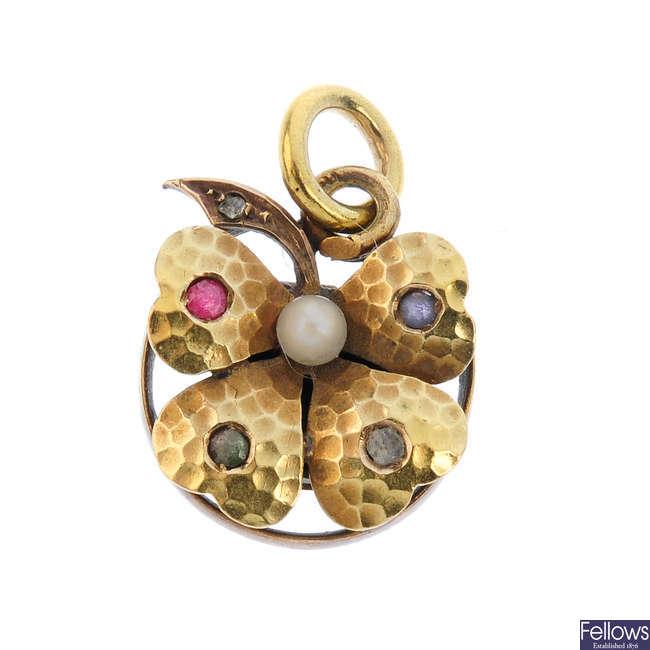 An early 20th century gold gem-set locket.