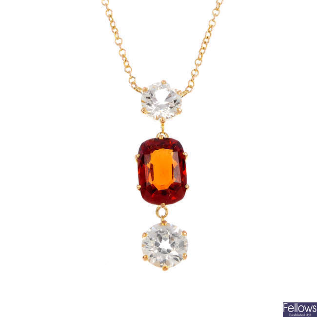 A sapphire and garnet pendant, on chain.