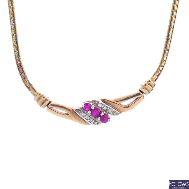 A 9ct gold diamond and ruby necklace.